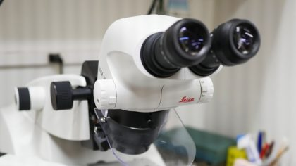 White microscope with black viewing lenses