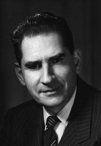 Black and white photo of person in suit and tie