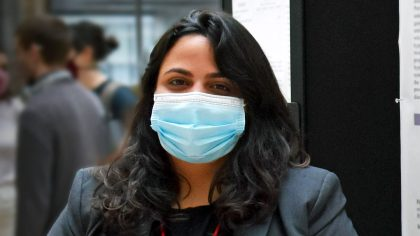 Woman wearing mask at scientific poster session